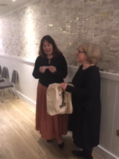 After sharing her career ups and downs, ICAEW member Julie Deane OBE (founder of the Cambridge Satchel Company) drew the winning ticket in a raffle to win one of her brand's bags, raising over £500 for local charity One25