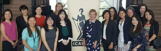 Attendees posing for a group shot around an ICAEW banner, including Fiona Wilkinson and Sharron Gunn.