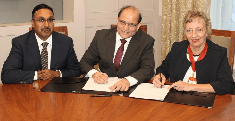 ICAI Vice President Atul Kumar Gupta, ICAI President Prafulla P. Chhajed, and ICAEW President Fiona Wilkinson sign a memorandum of understanding