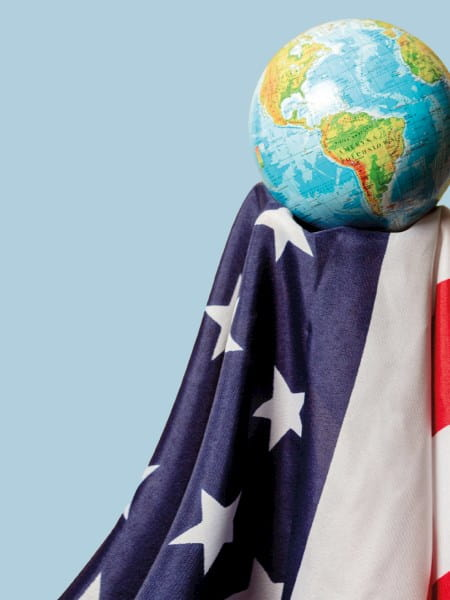 Globe held by USA flag