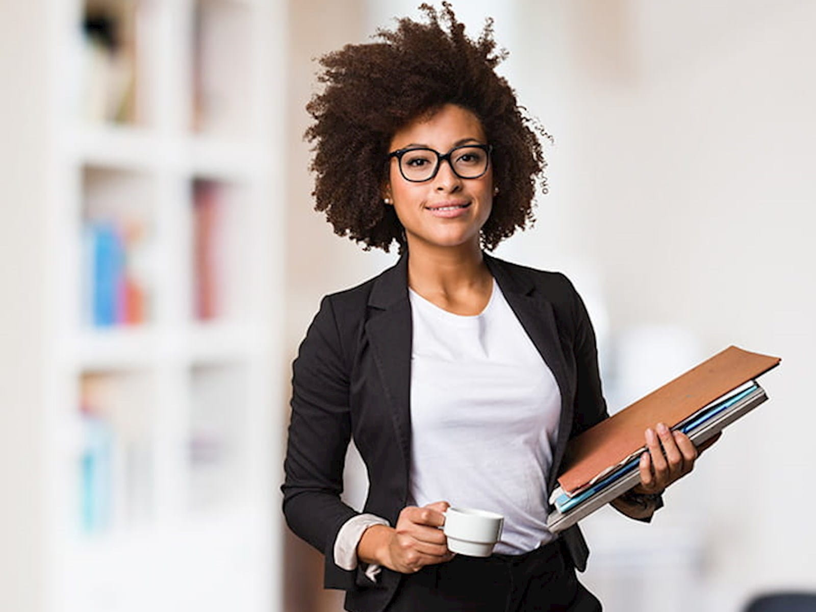Professional woman holding files