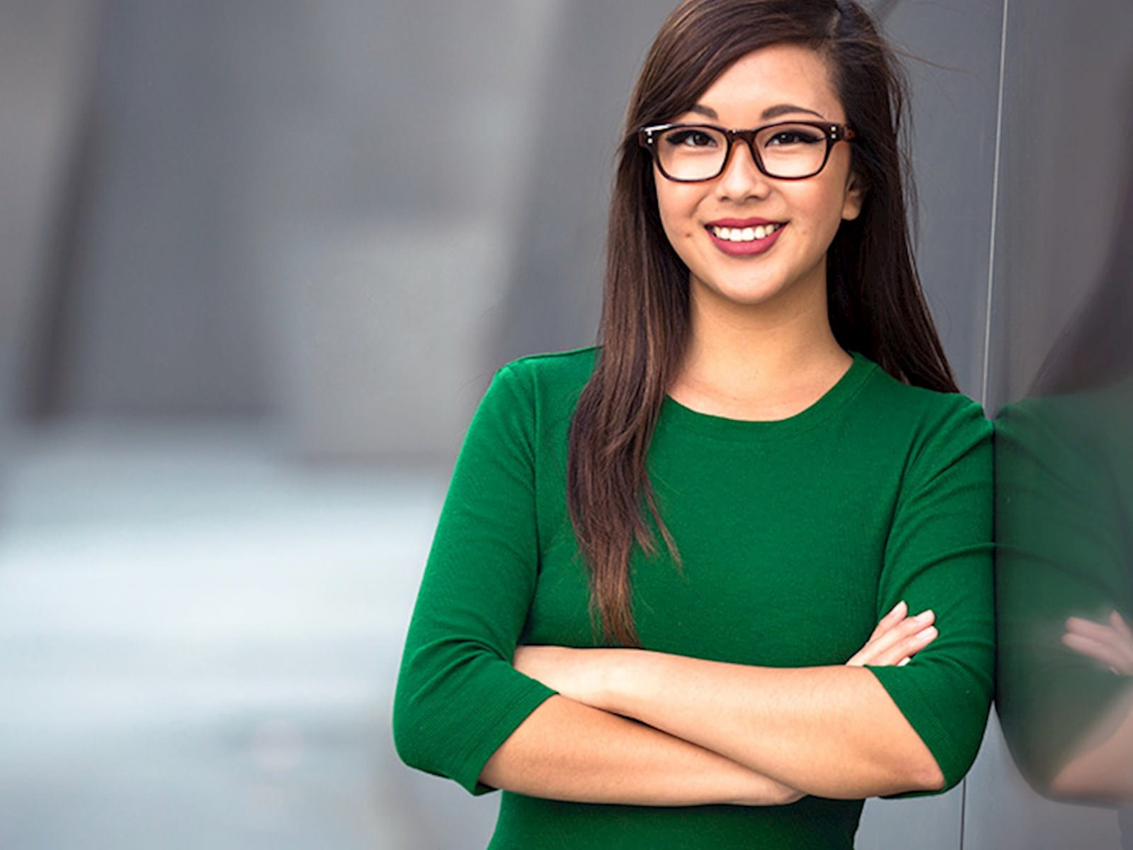Professional woman in green top