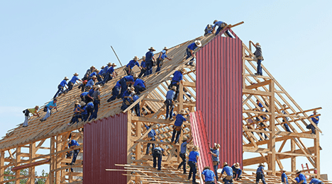 A timber-frame building under construction.