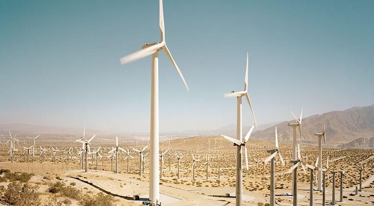 Wind turbines on arid terrain