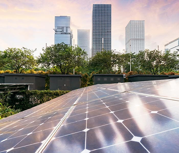 Solar panels, greenery and skyscrapers