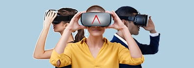 Three people wearing VR goggles
