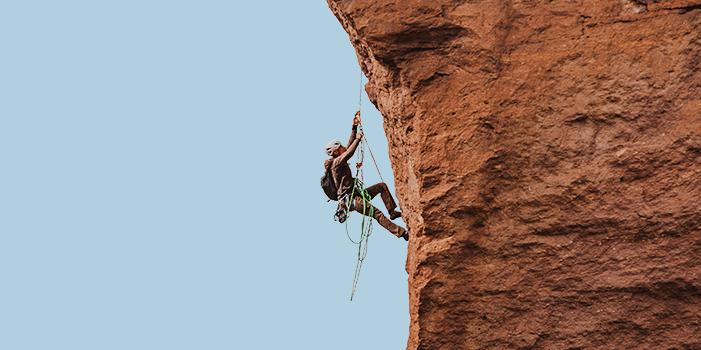 Person climbing a rock face