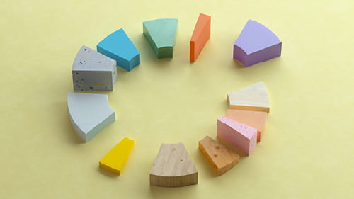 Coloured wooden blocks representing an exploded pie chart