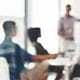 Blurry image of people in a business meeting