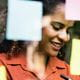 Smiling woman surrounded by Post It notes