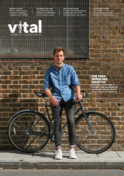 The front cover of the October 2019 edition of Vital magazine, featuring a photograph of a young man with a bicycle standing in front of a building.