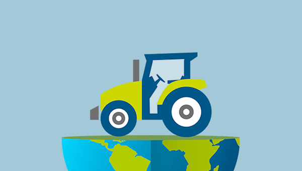 A tractor sitting on top of the bottom hemisphere of planet Earth