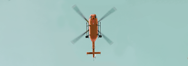 A red helicopter seen from below